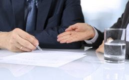 The Two business partners signing a document